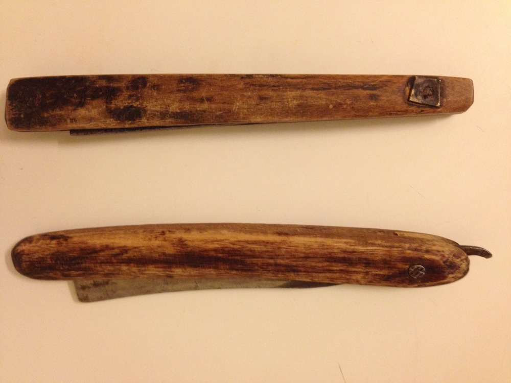 "Top razor: 1700s. No ""monkey tail"". Bottom razor: 1800s. A small ""monkey tail""."